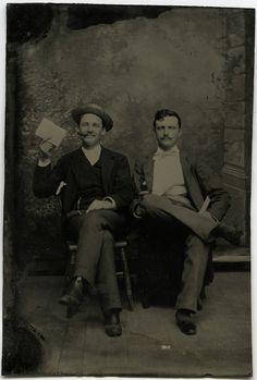 Men with paper frames, via Flickr.