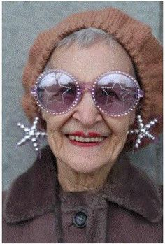 ~ 80 year old Rita owns over 70 pairs of outrageous sunglasses, and wears them beautifully ~