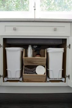 Kitchen Cabinets Remodeling Install pull out drawers to keep trash bins underneath your kitchen sink. - It can get pretty messy underneath our kitchen cabinets. These under sink organization ideas will show you how to declutter in no time. Kitchen Cabinet Storage, Kitchen Cabinetry, Storage Cabinets, Kitchen Organization, Kitchen Pull Out Drawers, Organization Ideas, Kitchen Bins, Kitchen Cabinet Door Styles, Kitchen Cleaning