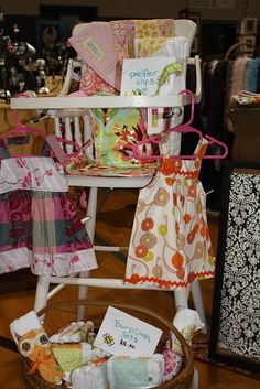 Using a vintage high chair to display items at a craft fair
