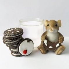 "Charming Tails Figurines Mice, a collectible based on the work of artist Dean Griff, are adorable little creatures in ""people"" situations. They..."