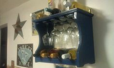Repurposed plate rack: moved a few dowels and added t-molding from the flooring department and now I have a new wine glass holder and wine rack all in one.