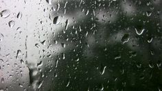 Rain running down window. - HD stock video clip