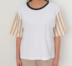 Clean top with stripes sleeves and contrast neckline binding. Total 2 combos, shop @ www.lindasbang.com