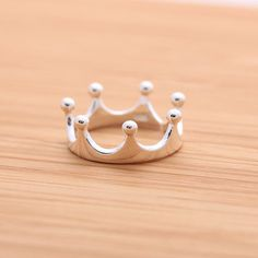 I want these if i ever have a daughter :): Sterling Silver Simple TIARA ring, available in gold, silver, pinkblue.