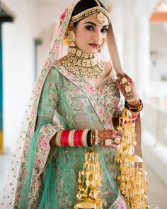 love this brides multi coloured bridal lehenga. wedding jewellery Where Can One Shop Wedding Jewellery Online -