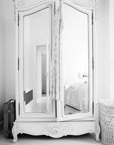 armoire with mirrors - less dated than mirrored sliding closet doors, but still allows more light and for such a big piece not to look so imposing.