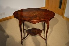 A beautiful Late Victorian Period rosewood and marquetry inlaid antique occasional table.