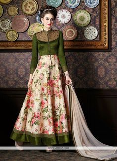 Unfold the aura of freshness with this green silk anarkali salwar kameez showing a touch of sensuality. The ethnic patch border and print work over a attire adds a sign of magnificence statement for t...