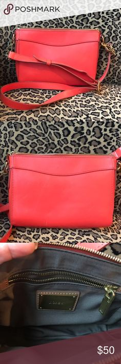 J. Crew Leather orange cross body bag Cute bright and fun bag! Perfect amount of color to any outfit! It has a small pen mark at the bottom of the purse. J. Crew Bags Crossbody Bags