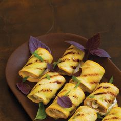 Summer Squash, Goat Cheese, and Herb Roulades Recipe Appetizers with yellow crookneck squash, olive oil, fresh chevre, black olives, lemon zest, basil