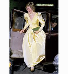 Princess Diana, March 1985. Reminiscent of Beauty and the Beast. Take a look at her gold shoes.