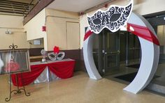 Quinceanera Masquerade Theme in Apple Red and Silver with a Bling Entry Table Decor and Round Arch Entry