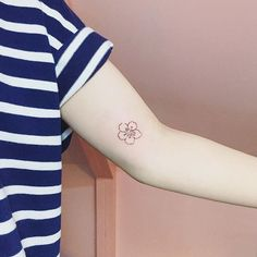 Cherry blossom tattoo by Ida. #linework #miniature #flower #cherryblossom #tiny…
