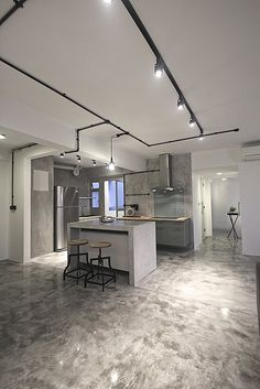 """Cement screed was polished, giving it the same treatment that marble floors would receive. The result is a glossy sheen that looks unique and retain the """"raw"""" characteristic."""