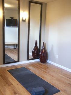 The mirrors are a good idea to incorporate to a yoga room design