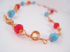 Copper Spiral Wire Wrapped Necklace with Red and Turquoise Swarovski Crystals