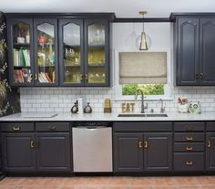 Interesting cabinet color and an unexpected pop of color inside the kitchen cabinet  Pulls are fun too
