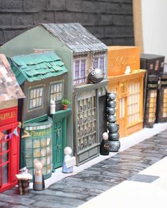 After several lovely weekends of taping and painting cardboard boxes, and eating tubs of Pringles and yoghurt in order to release the containers for crafting, Harry and I are delighted to announce . Harry Potter Toys, Harry Potter Diagon Alley, Mundo Harry Potter, Harry Potter Decor, Harry Potter World, Cardboard Painting, Cardboard Play, Cardboard Castle, Harry Potter Bricolage