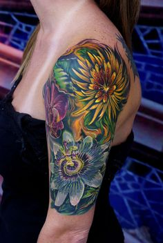 partial sleeve, my next tattoo just different flowers.. can't wait till my bday!!