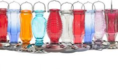 These Perky-Pet Vintage Glass Bottle Bird Feeders + Waterer are gorgeous!