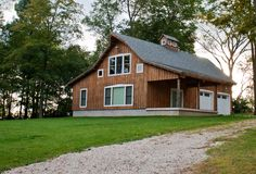 Barn Home with attached garage and open porch.  www.sandcreekpostandbeam.com https://www.facebook.com/pages/Sand-Creek-Post-Beam-Traditional-Post-Beam-Barn-Kits/66631959179