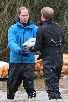 Prince William, Duke of Cambridge and Prince Harry help with flood defences around a school on February 14, 2014 in Datchet, United Kingdom