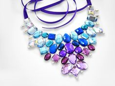 Bright+royal+blue,+baby+blue,+aqua+crystal+AB+(aurora+borealis/+rainbow+coated)+and+purple+rhinestone+jewels+decorate+this+sparkling+bib+necklace.+I+wanted+to+create+an+elegant+bib+necklace+that+variegated+from+bright+blues+to+a+deep+royal+purple.+A+hint+of+crystal+AB+stones+add+contrast+and+even...