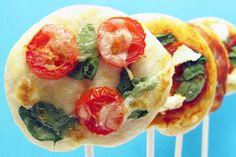 Pizza Dough + Tomato Sauce + Fresh Mozzarella + Basil + Arugula + Goat Cheese + Ricotta Cheese + Cherry Tomatoes + Fresh Spinach