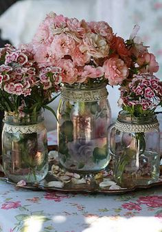 Gorgeous jam jars with country style flowers--never enough ideas for mason jars!