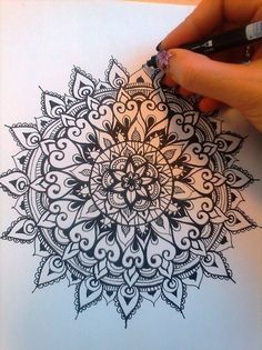 Mandala by pen. Meditative practice, create something beautiful and calm.