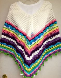 free pattern for this great poncho! (click where it says ICIKLIKLIK) :-)