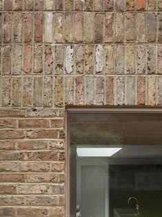 Riversdale Road is a minimalist home located in London, United Kingdom, designed by O'Sullivan Skoufoglou Architects Brick Architecture, Architecture Details, Contemporary Architecture, Sunken Patio, Glass Block Windows, Brick Detail, Victorian Terrace House, Dark Wood Kitchens, Brick Facade