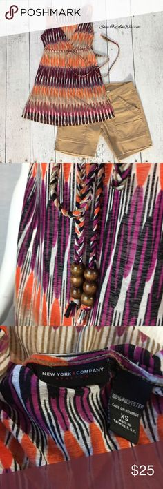 NY&Co tribal print sleeveless drawstring top Pretty v-neck sleeveless tribal print top with empire drawstring waist with wooden bead ties. Great condition, smoke free home. Please read updated bio regarding closet policies prior to any inquiries. New York & Company Tops