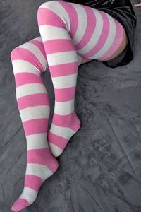 Striped thigh highs that fit curvier legs.  Yessss.  Love the pink and white.