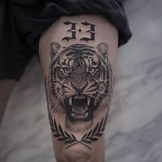 Lion Tattoos That Define Perfection Tiger and Lion Tattoos That Define Perfection - Tattoo artist Lazer Liz, authors style black&grey floral and animal tattoo Tiger Tattoo Thigh, Tigh Tattoo, Tiger Tattoo Sleeve, Thigh Tattoo Men, Knee Tattoo, Forearm Tattoos, Sleeve Tattoos, Mens Leg Tattoo, Tiger Face Tattoo