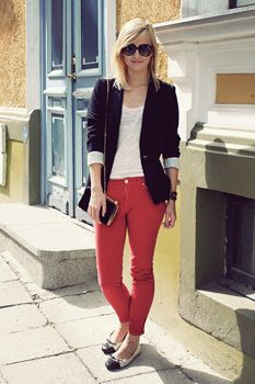 black blazer with bright colored jeans