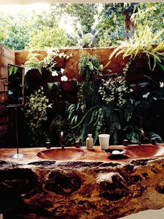Indoor/outdoor bathroom of Casa Éstudio Uxua Casa Hotel in Trancoso, Bahia.