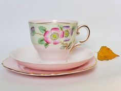 This gorgeous cup, saucer and plate are made from pink bone china in England. The tea cup and saucer are made by Tuscan Fine china and date from the