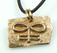 """Brimstone Talisman - This is a """"dark"""" pendant that represents """"Brimstone"""" and """"sulphur"""" in ancient symbolism. Perhaps it could be worn to ward off evil spirits?    Pendant is made of kiln fired bronze (fired with brimstone LOL!) and measures 1"""" wide x .75"""" tall. Round leather cord necklace adjusts from 20"""" to 16"""" in length."""