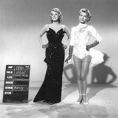 "Rosemary Clooney and Vera Ellen in White Christmas wardrobe test for costumes worn in the ""Mandy"" number. The neckline of Rosemary's black gown was subsequently altered for filming. Costumes designed by Edith Head. Hooray For Hollywood, Golden Age Of Hollywood, Vintage Hollywood, Hollywood Glamour, Hollywood Stars, Classic Hollywood, White Christmas Movie, Christmas Movies, Christmas Scenes"