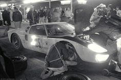http://chicerman.com  awesomecars:  A Ford GT40 in the pits during the 1966 24 hours of Daytona GT40s would catpure a 1-2-3 sweeping finish defeating Ferrari and presaging the legendary LeMans win. [2700x1800]  #cars