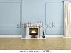 fireplace in an empty apartment with a wooden floor.