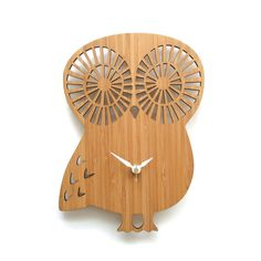 """Create a warm and inviting room with this owl clock as wall decor. This large owl clock comes with or without numbers. FEATURE• Size: 8"""" x 10"""" • Eco-friendly 3ply bamboo**  • White hour and minute hands • Gold second hand • Silent Clock Motor • Hanger on the back (wall hanging with pushpin) • Requires one AA battery • Ships well protected  ** Because of the nature of bamboo, grains and color will be different from the pictures shown."""