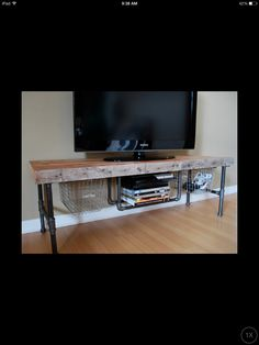 TV stand. Wood beams and gas pipes