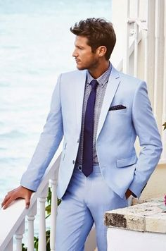 Shop this look on Lookastic: https://lookastic.com/men/looks/light-blue-suit-light-violet-dress-shirt-violet-tie-navy-pocket-square/12203   — Light Blue Suit  — Navy Polka Dot Pocket Square  — Violet Tie  — Light Violet Print Dress Shirt