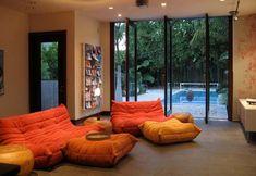 Togo Sofa Among Orange Color Design  as Luxury Living Room Interior Inspiration