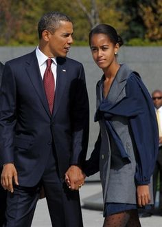 Malia Obama, with her father, the President of the USA.