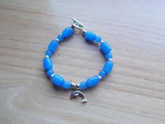 Dolphin and blue glass beaded bracelet by SecChnceTreasure on Etsy, $30.00