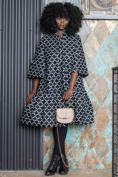 The stunning Dola Dress coat is simply a show-stopper. This look can be worn as a dress, coat or cardigan. Shop modern dutch wax print dresses at Kuwala. African Inspired Fashion, African Print Fashion, Fashion Prints, Arab Fashion, Look Fashion, Ski Fashion, African Print Dresses, African Dress, Modesty Fashion